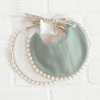 Bib Pompom green and cream
